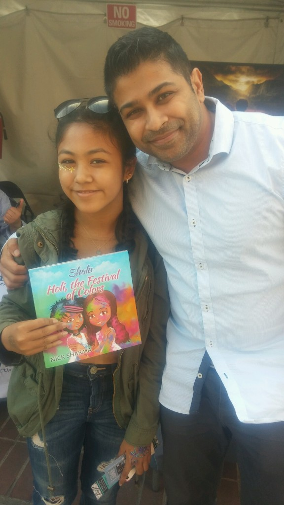 Author Nick Sharma stops to take a picture with a stylish fan at the LA Festival of Books showcasing Holi, The Festival of Colors