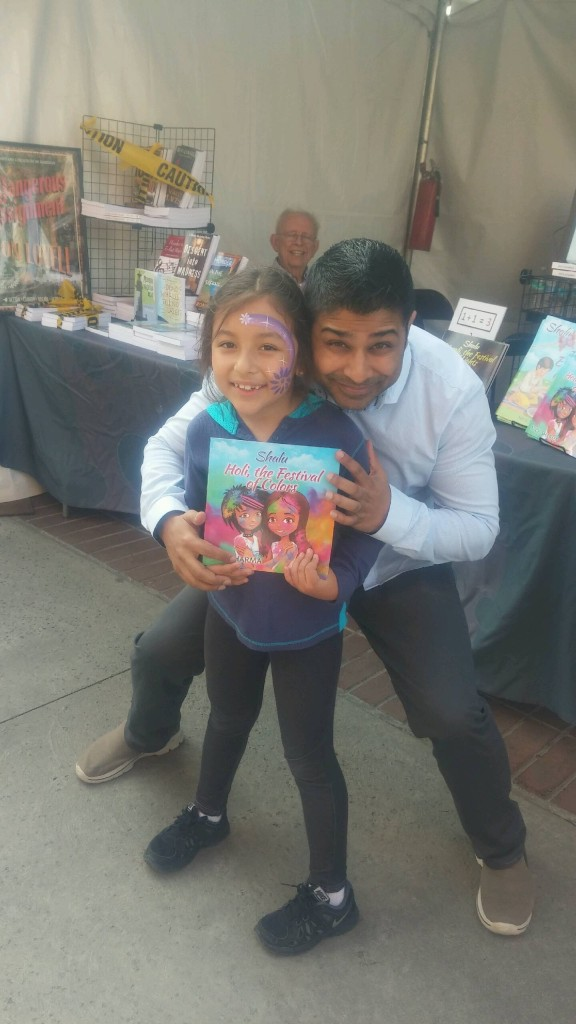 Author Nick Sharma stops to take a quick picture with a fan at the LA Festival of Books showcasing Holi, The Festival of Colors