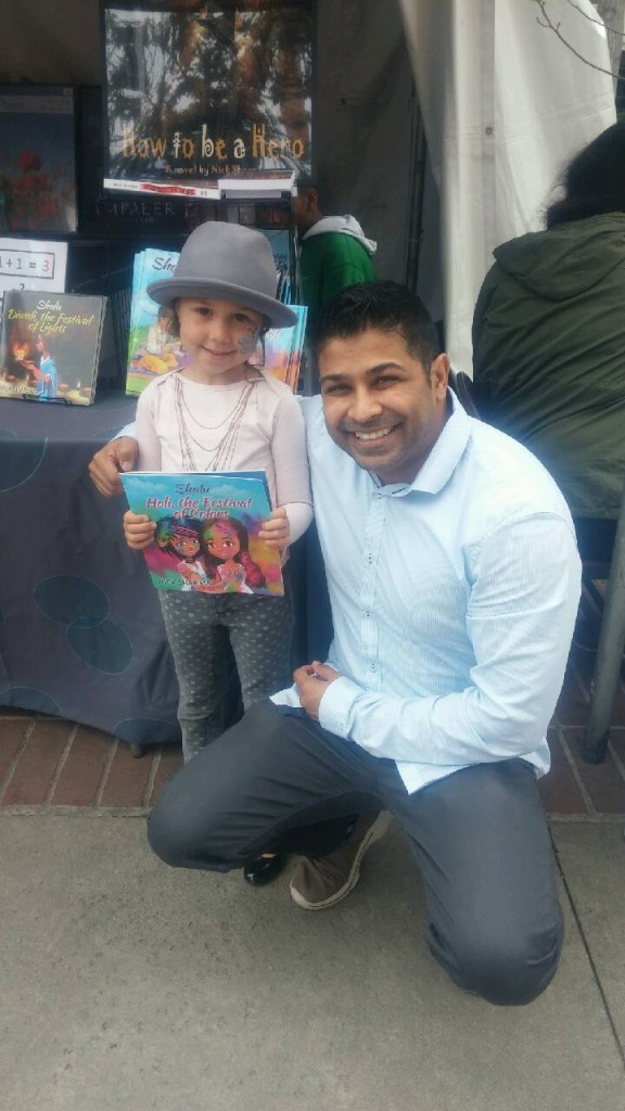 Author Nick Sharma stops to take a picture with a fan with style at the LA Festival of Books showcasing Holi, The Festival of Colors
