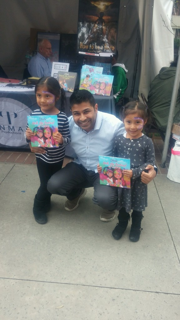 Author Nick Sharma stops to take a picture with some little fans at the LA Festival of Books showcasing Holi, The Festival of Colors