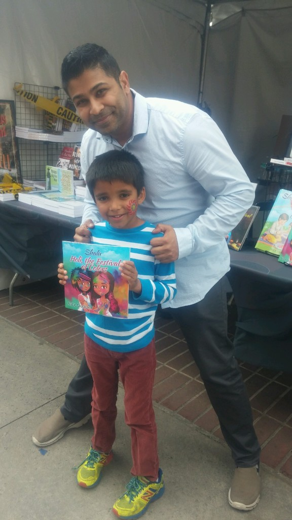 Author Nick Sharma stops to take a picture with a fan at the LA Festival of Books showcasing Holi, The Festival of Colors