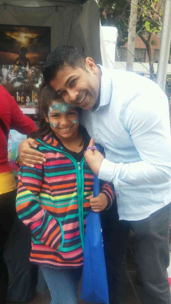 Author Nick Sharma stops to take a picture with a fan at the LA Festival of Books premiere Holi, The Festival of Colors