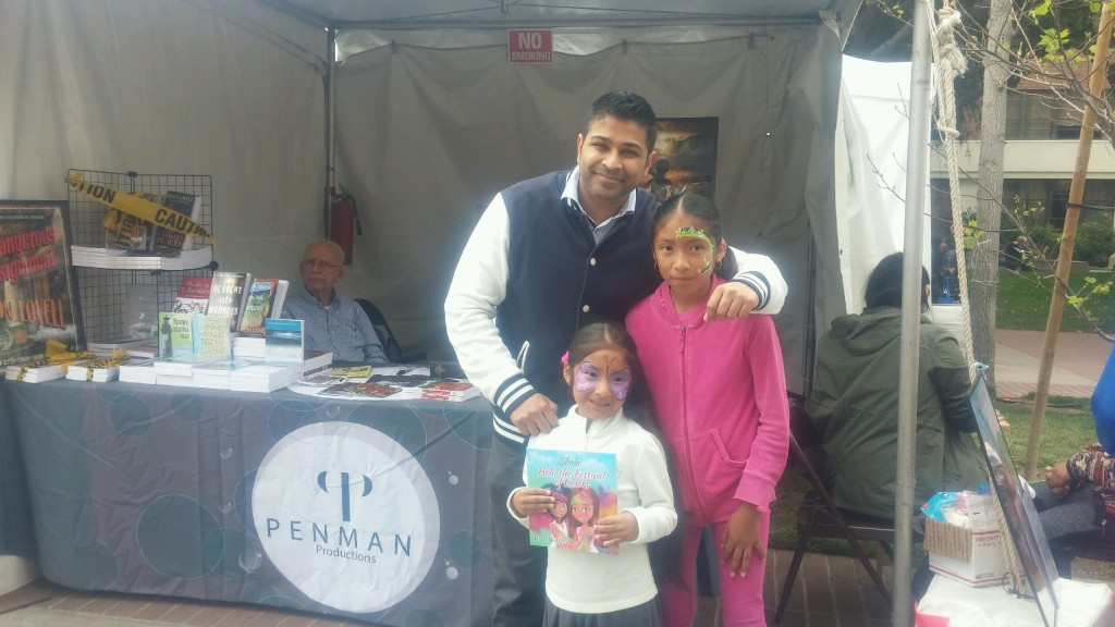 Author Nick Sharma takes a pic with some wondersful children at the LA Festival of Books showcasing Holi, The Festival of Colors