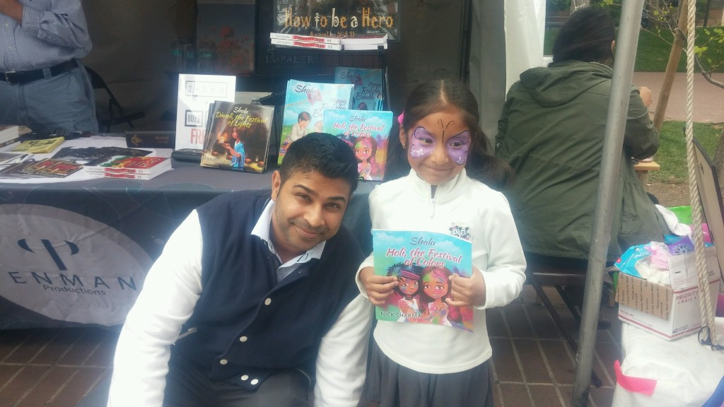 Author Nick Sharma takes a pic with a shy fan at the LA Festival of Books showcasing Holi, The Festival of Colors