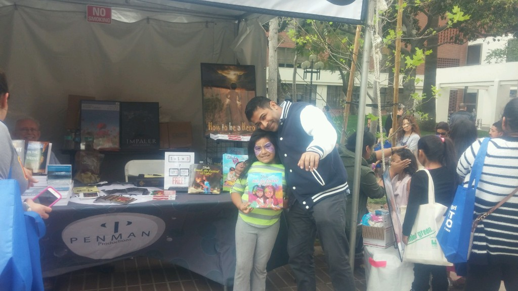 Author Nick Sharma takes a pic with some fans at the LA Festival of Books showcasing Holi, The Festival of Colors