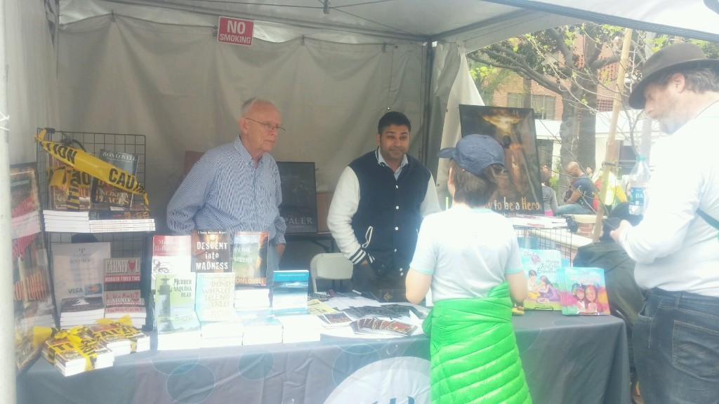 Authors Nick Sharma and Ron Lovell speak to some fans about their books at the LA Festival of Books
