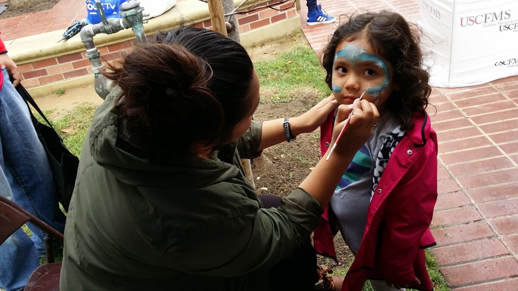 Karina Ramirez doing some beautiful work on a patient kid at the LA Festival of Books