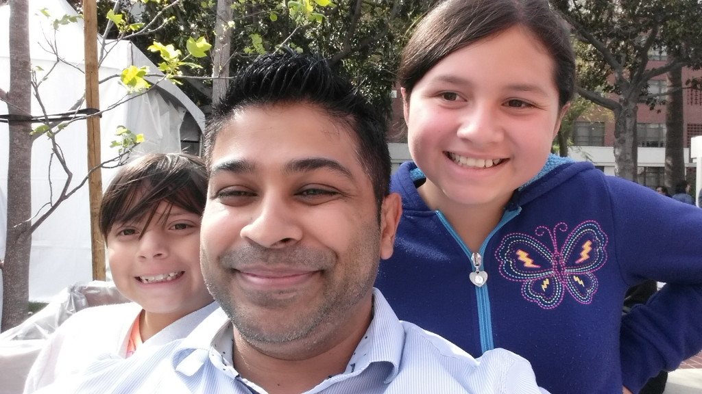 Author Nick Sharma takes a selfie with some kids that are spreading the joy of reading