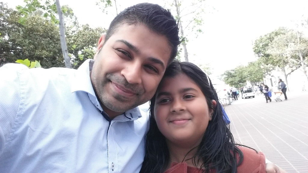 Author Nick Sharma posing with a fan at LA Festival of Books in Los Angeles